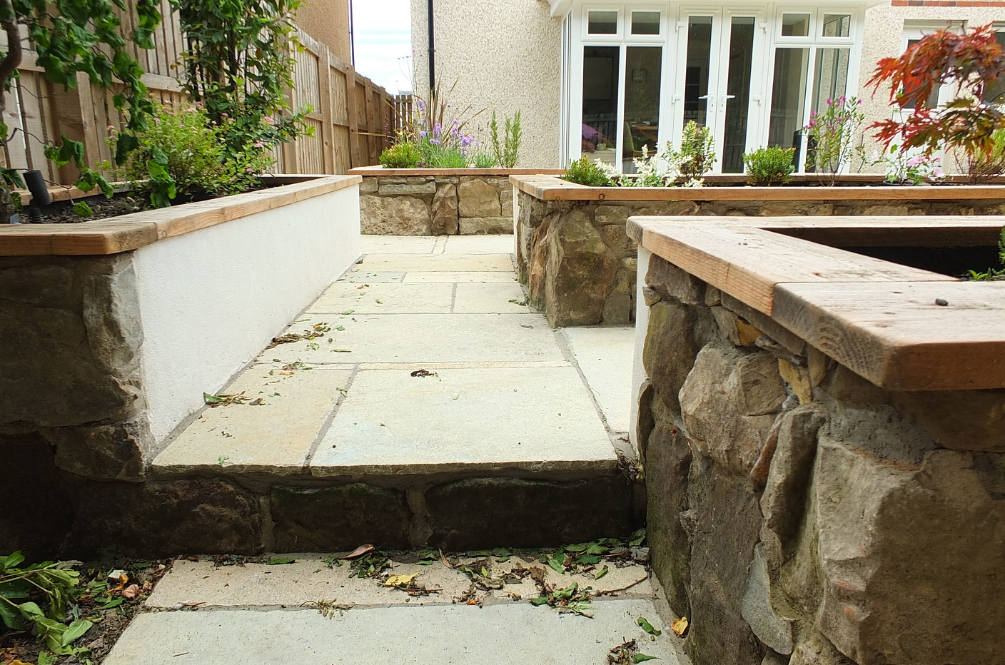 Stone wall raised beds lime render Modern garden Edinburgh